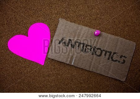 Text sign showing Antibiotics. Conceptual photo Antibacterial Drug Disinfectant Aseptic Sterilizing Sanitary Old damaged paperboard ideas message purple heart love lovely intentions poster