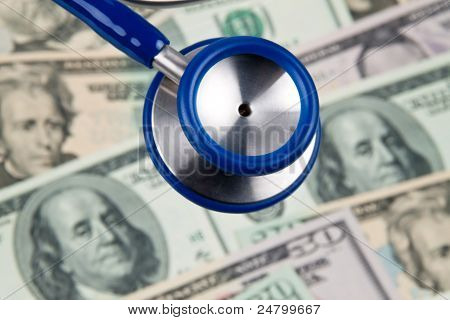 dollar currency notes and stethoscope