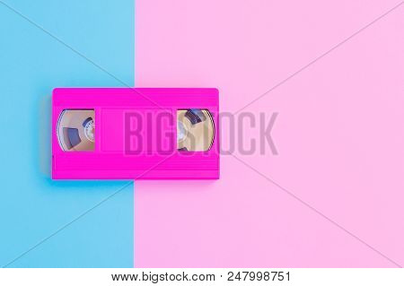 Vhs Cassette On Soft Pink And Blue Paper Background. Minimal Concept. Creative Concept. Cinema Conce