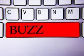 Handwriting text writing Buzz. Concept meaning Hum Murmur Drone Fizz Ring Sibilation Whir Alarm Beep Chime Keyboard red key Intention create creating message idea communicate paper poster