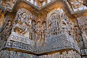 Sculptures west side walls. Shiva on the left and Vishnu on the right. Hoysaleshwara temple, Halebidu, Karnataka, India. view from West. poster