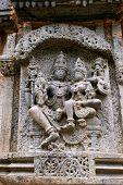 Sulpture Lakshmi sitting in the lap of Vishnu. Kedareshwara Temple, Halebid, Karnataka, India. North Wall. poster