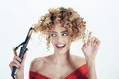 Hairdresser. Satisfied curly hair girl holds hairdresser equipment. Beauty industry profession. Beauty and style. Makeup and cosmetics for hair care. Isolated on white background. Hairdresser tool. poster