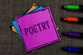 Text sign showing Poetry. Conceptual photo Literary work Expression of feelings ideas with rhythm Poems writing Multiple colour sticky remember cards pen script marker jute background poster