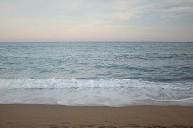 Late Afternoon View Of The Sea From The Beach Near Port Vell, Barcelona (catalonia, Spain).