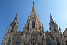 Cathedral Of The Holy Cross And Saint Eulalia In Barcelona (catalonia, Spain) Against A Blue Sky In