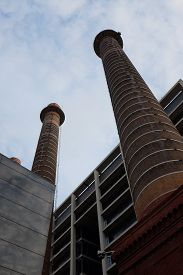 Traditional Industrial Funnel Tower Structures In Barcelona (catalonia, Spain) Against Blue Sky In S