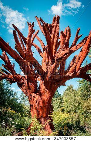 Frederik Meijer Gardens- Grand Rapids, Mi /usa - September 4th 2016: Red Tree Statue Standing Tall A