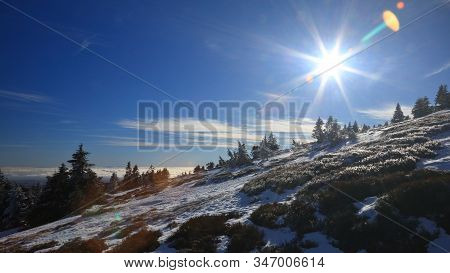 Winter Snowy Landscape On A Sunny Day Above Clouds
