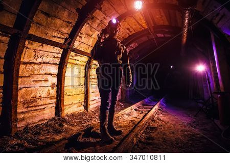 Miner Working A Jackhammer In A Coal Mine. Work In A Coal Mine. Portrait Of A Miner. Copy Space.