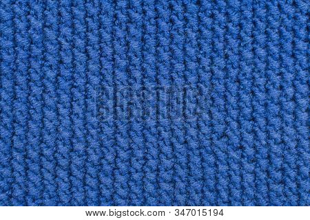 Knitted Fabrics. Background Of A Knitted Fabrics. Blue Cloth With Diagonal Stripes Knitted By Hand.
