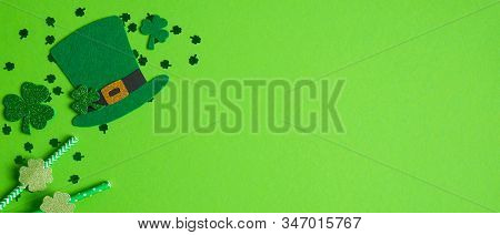 St. Patrick's Day Banner With Irish Elf Hat, Cloverleafs And Drinking Straws Decorated Shamrock Leaf