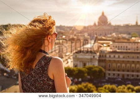 Young Pretty Woman Admiring The View Of Rome, Italy, Europe. Beautiful Sunny Skyline Of Rome In Summ