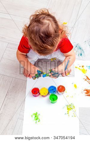 Baby Drawing  Multi-colored Finger Paints.  Prescool Developing. Vertical