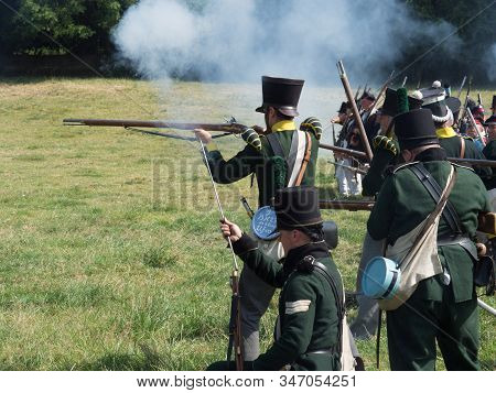 Waterloo, Belgium - June 18 2017: Soldiers Of The Allied Forces Fire Their Muskets During The Re-ena