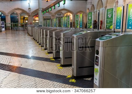 Lisbon, Portugal - January 18, 2020: Train Fare Ticket Stations For Passengers To Pay And Validate T