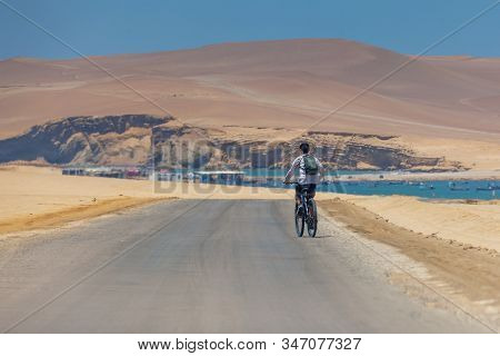 Man On Bicycle, Paracas National Reserve Desert, Pisco, Peru 2019-12-05