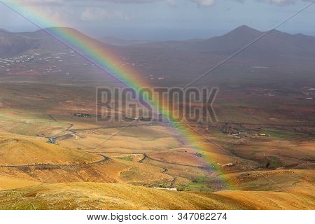 Panoramic View At Landscape From Viewpoint Mirador Morro Velosa On Fuerteventura, Spain With Rainbow