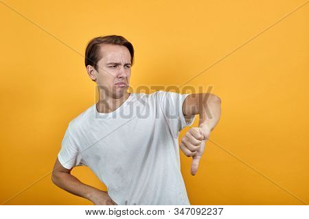 Man Shows Negative Gesture Male. Thumb Is Down