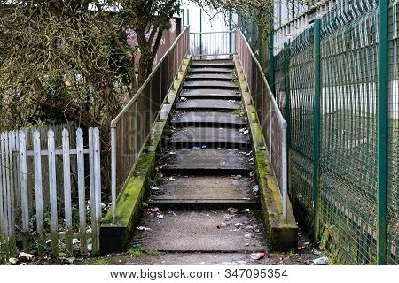 A Small Flight Of Stairs In A Disused Alleyway Near The Railway
