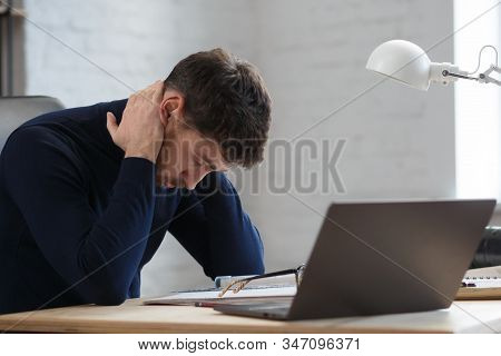 Tired Architect Working Overtime In Office. Stressed Businessman Have Financial Problems And Searchi