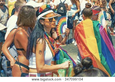 The Annual Parade Lgbt. Lesbians Walking In The Gay Pride Parade. Parade Of Tolerance. Rainbow Flags