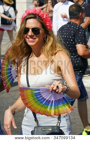 The Annual Parade Lgbt. Lesbian Walking In The Gay Pride Parade. Parade Of Tolerance. Rainbow Flags