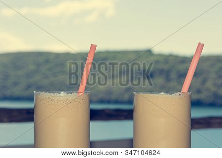 Pair Of Delicious Frappe Coffee With Straws Ready To Enjoy At The Beach.