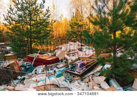 Garbage Dump In The Forest. Garbage Dumps Are An Environmental Problem Of Our Days.