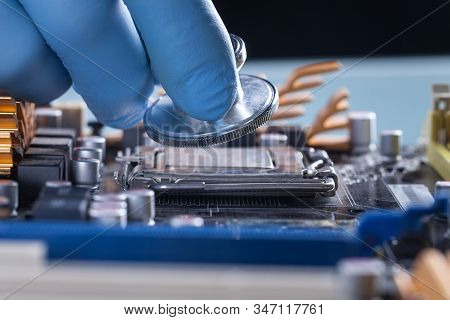 Scientist Or Doctor Working With A Computer Motherboard