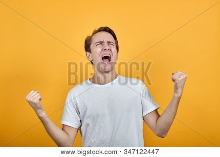Emotion Despair And Fear Rage. Raises His Hands In Rage Screams With His Mouth Open