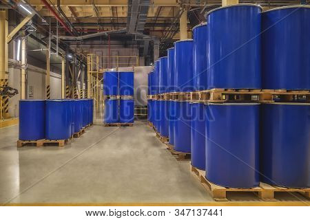 Blue Metal Barrels. Chemical Industry. Metal Barrels For Chemicals. Storage Racks. Barrels Are Store