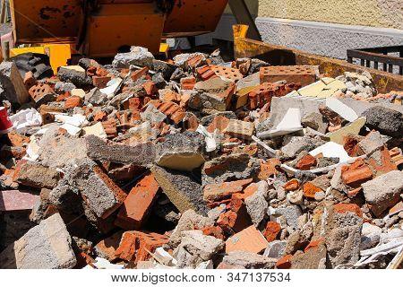Disposed Red Bricks Piled Up On Junkyard. Brick Rubble