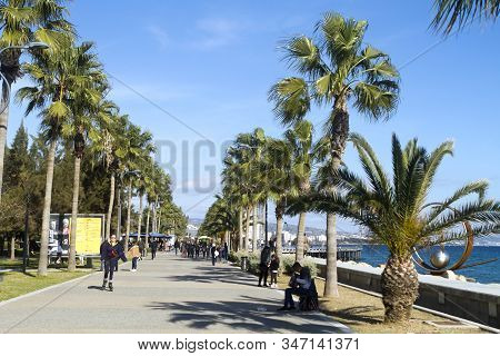Limassol, Cyprus, January 26th, 2020: Seafront Promenade Molos With Walking People On A Winter Sunny