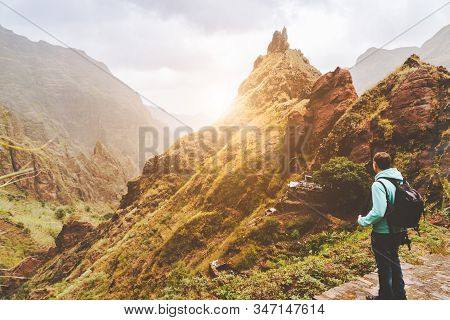 Santo Antao Island, Cape Verde. Traveler Man With Camera On Sunset In Front Of Mountain Ridge And Ra
