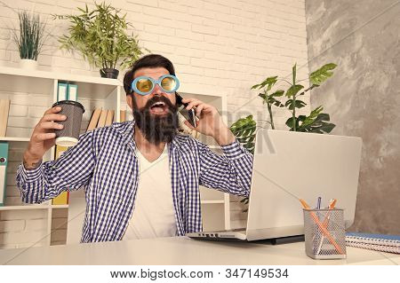 Cup Of Coffee Is Really About Communication. Bearded Man Communicating By Smartphone. Hipster Workin