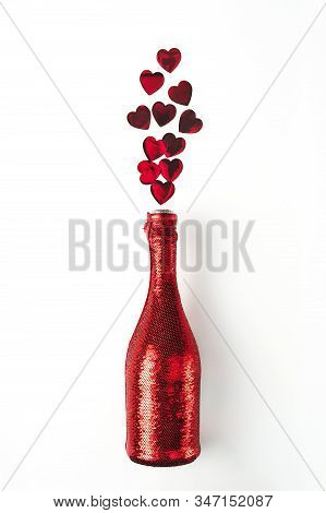 Vibrant Red Heart-shaped Confetti Poured Out Of Champagne Bottle In Cover Spangled With Vibrant Red