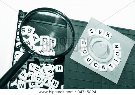 Sex education concept with key words and condom on game board poster