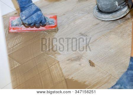 Builder Applying Grouting On Shower Tiles In Bathroom Gray Cement Mortar