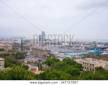 Barcelona, Spain. May 2019. View Of Barcelona City With Port Vell From Montjuic Hill In Cloudy Day.
