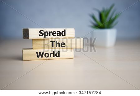 Spread The Word Word Written On Wood Block. Spread The Word Text On Table, Concept.