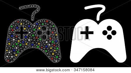 Glowing Mesh Games Console Icon With Lightspot Effect. Abstract Illuminated Model Of Games Console.