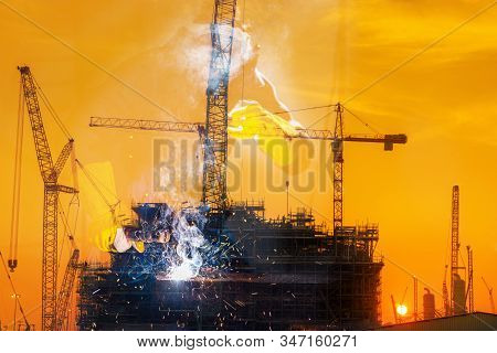 Double Exposure Of Welder Is Welding Pipeline Fabrication Assembly With Oil Rig Platform Background.
