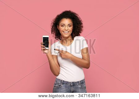 Smiling Afro Girl Showing Empty Screen Of Mobile Phone.