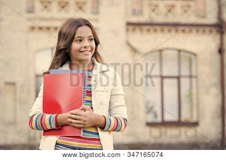 New Thought Arriving Daily. Small Cute Child Holding Book And Thinking A Thought Outdoor. Genius Lit