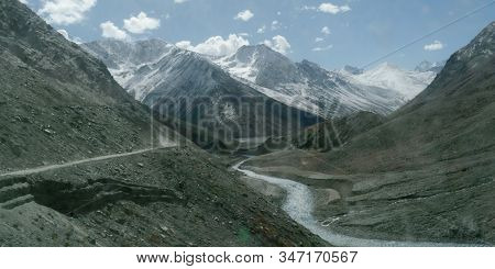 V-shaped Himalayas Valley Down Which A River With A Winding Course Flows. An Interlocking Overlappin
