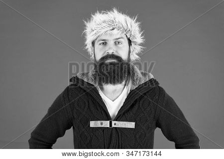 Winter Menswear. Clothes Design. Man Bearded Stand Warm Jumper And Hat On Red Background. Winter Sea
