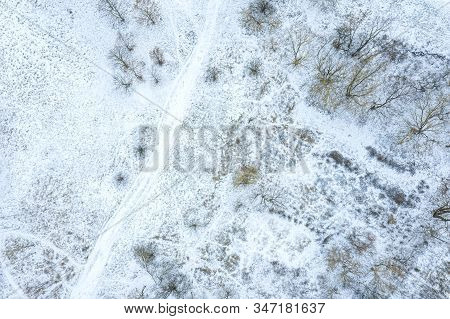 Aerial Top Down View Of City Park, Covered With First Snow. Winter Natural Landscape