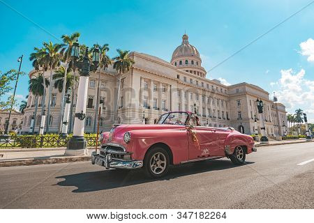 November 26, 2019, Havana, Cuba: Old Classic American Pink Car Rides In Front Of The Capitol. Retro