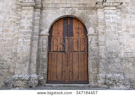 Old Wooden Door In Wall In Monastery. The Basilica And The Monastery Of San Francisco De Asis Or Sai